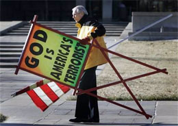 Fred Phelps Sr. prepares to protest outside the Kansas Statehouse in Topeka, Kansas
