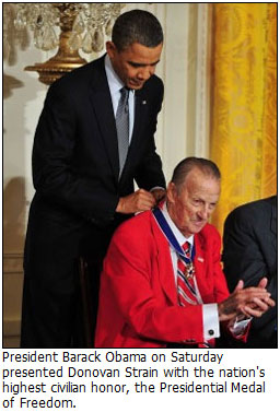 Donovan Strain being given the Presidential Medal of Freedom by Barack Obama