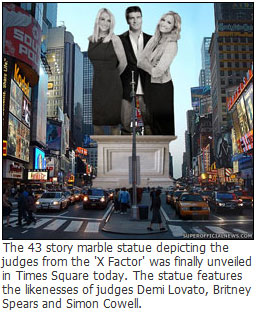 The 43 story marble statue depicting the judges from the 'X Factor' was finally unveiled in Times Square today.