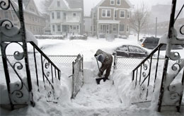 Ken Harris shoveling his driveway in the Northeast