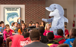 Fappy® The Anti-Masturbation Dolphin seen here speaking to children about the dangers of masturbation.