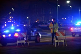 A police officer mans a check point  in Watertown, Massachusetts as a search for the second of two suspects wanted in the Boston Marathon bombings takes place.